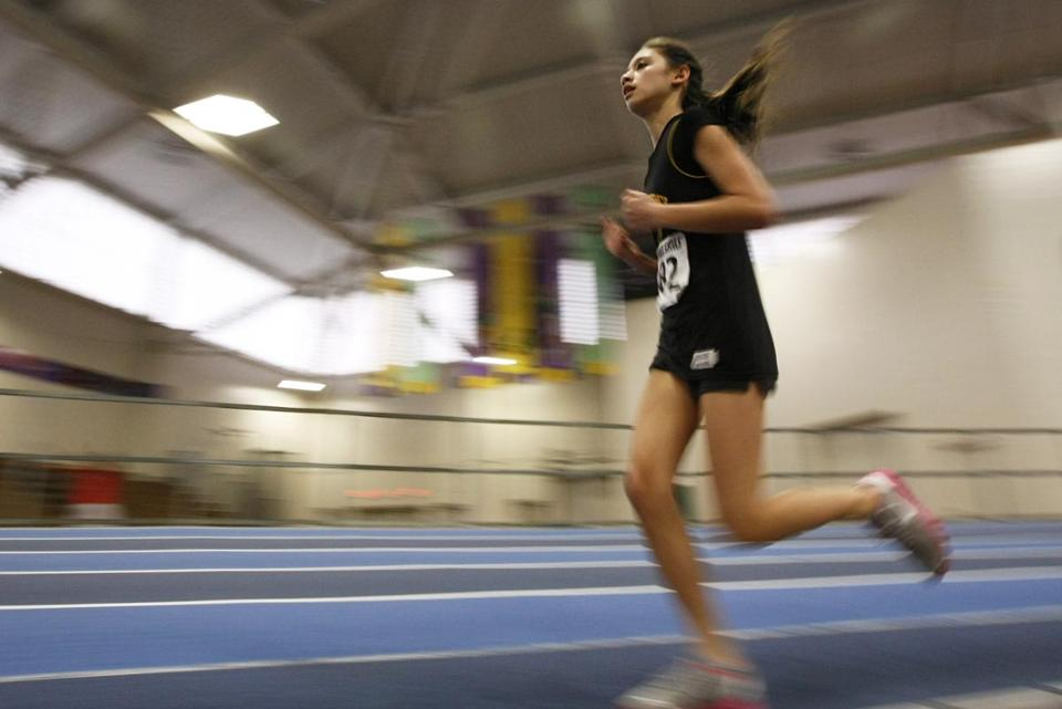 Latin Academy's Catherine Van Even finished according to plan in the mile race, winning in 6:39.77