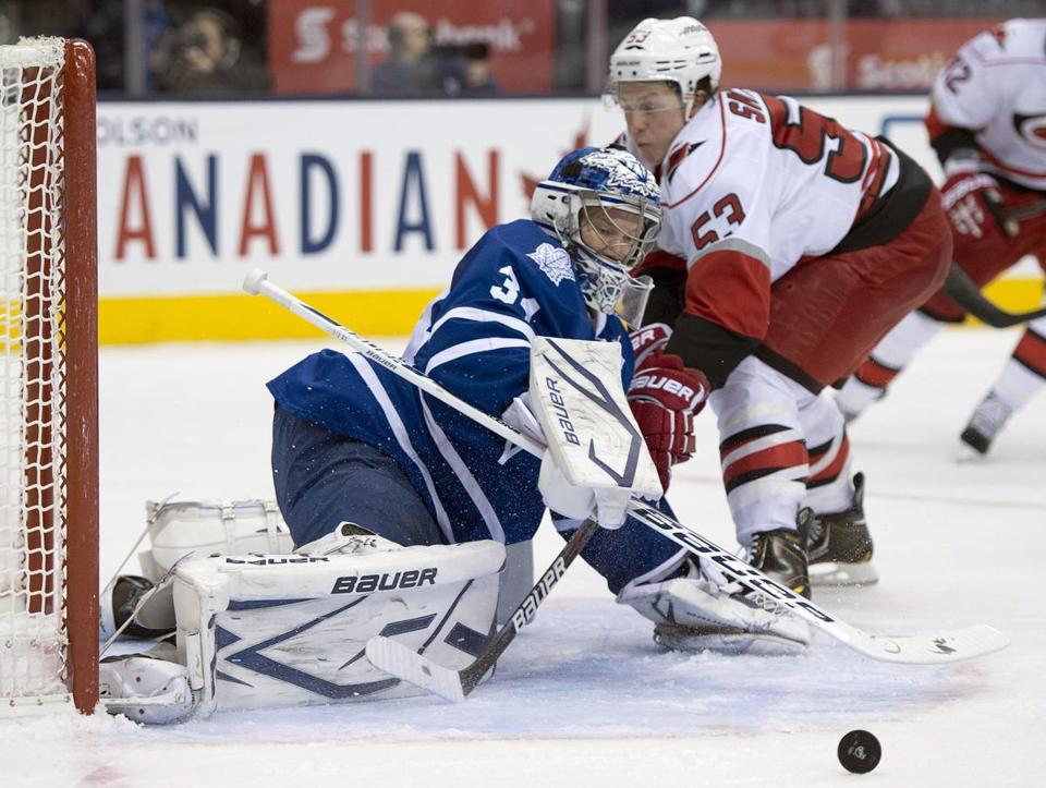 Toronto's James Reimer deflects a shot by Carolina's Jeff Skinner for one of his 35 saves.