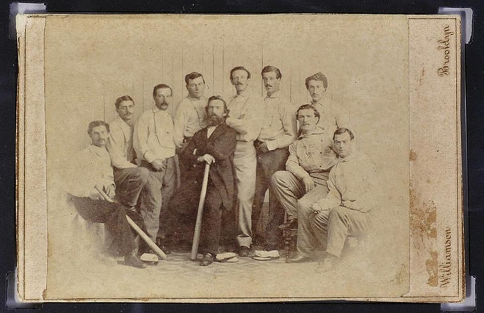 The card features a photo of the Brooklyn Atlantics, an amateur club that dominated its league in the early 1860s.
