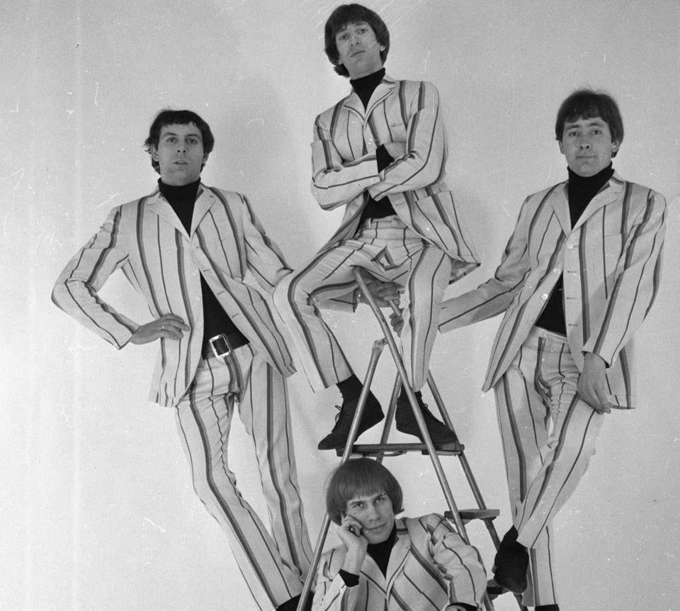 Reg Presley (right) and the Troggs, Chris Britton, Peter Staples, and Ronnie Bond, in their Carnaby Street suits.