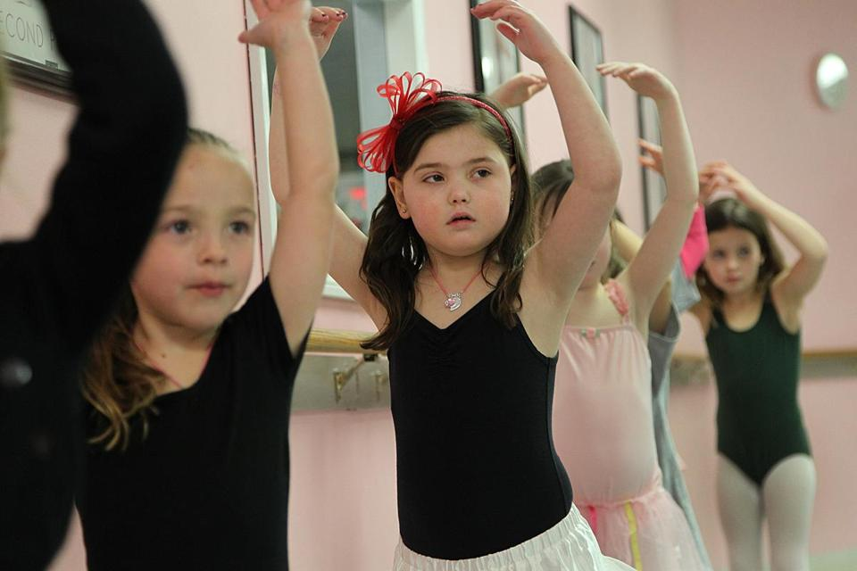 "Caroline ""Calle"" Cronk, who has a rare brain tumor, practices her dance moves with her friends during a class in Scituate."