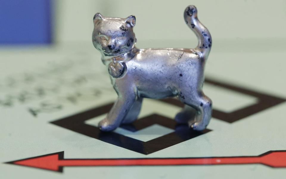 The Monopoly game got a new token, a cat, Thursday.