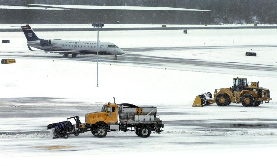 Snow was cleared from a runwayat Manchester-Boston Regional Airport in Manchester, N.H., in December.