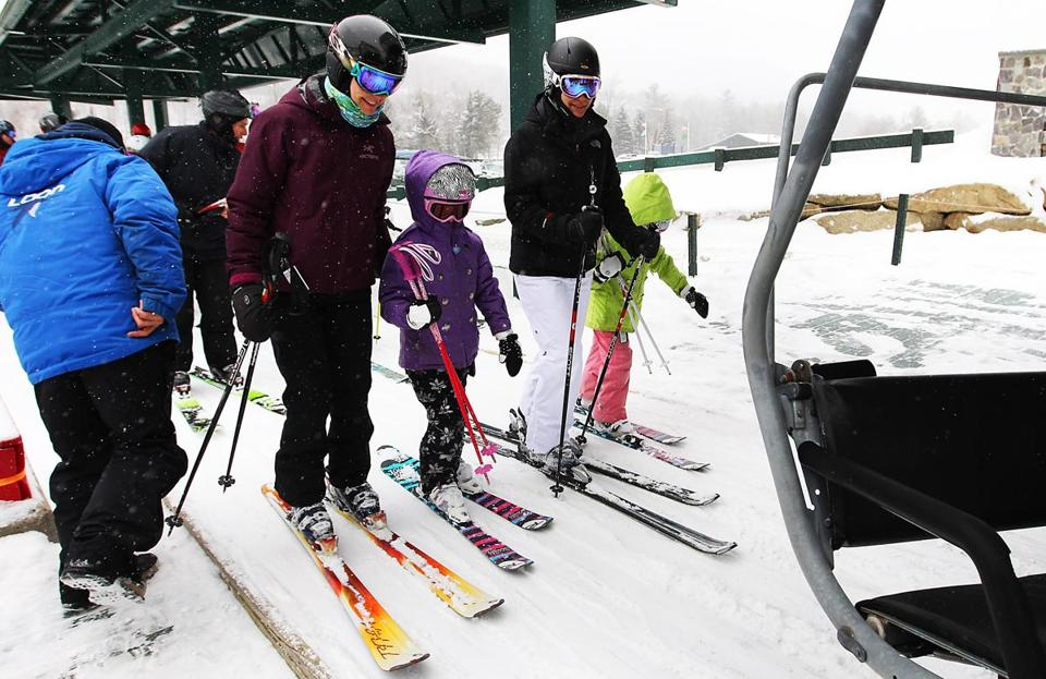 Skiers waited for the lift at Loon Mountain, which was expecting 10 to 12 inches of snow Friday.