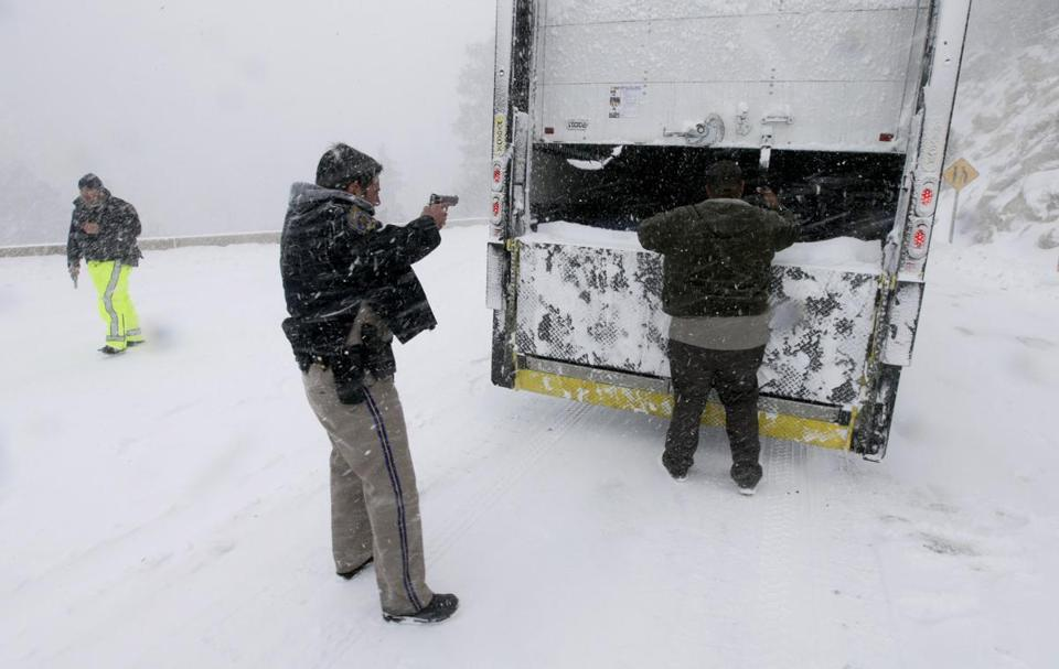 Members of the California Highway Patrol searched a truck for suspect Christopher Dorner on Friday in Big Bear Lake.