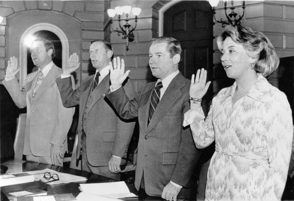 Senator William M. Bulger (second from right) took the oath of officewith other state senators as the 170th session of the Massachusetts Legislature convened in January, 1977.