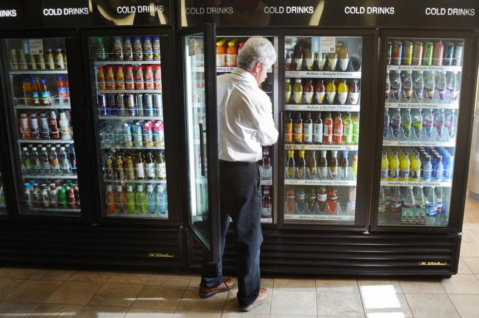 Jay Corbet of Coca-Cola can stock soft drinks but not water on campus.