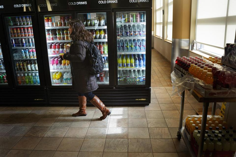 A student grabs a flavored seltzer water in the University of Vermont's cafeteria, The Marketplace, in the Dudley S. Davis Student Center, while flavored water and seltzer waters are still available after the banning of plastic water bottles on campus