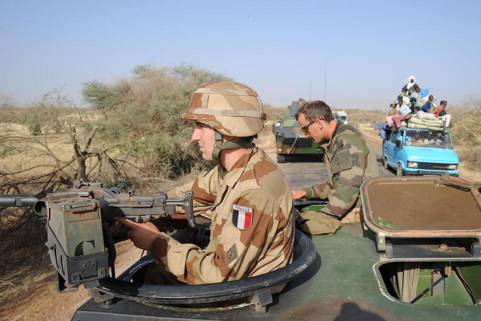 A local truck drove past a convoy of French Army vehicles Thursday heading from Gossi toward Gao, Mali, which the French were still trying to secure from Islamist militants.
