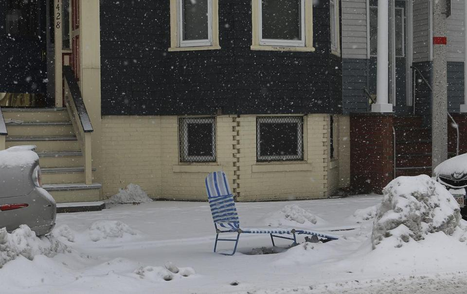 Chairs are commonly used to save coveted parking spots.