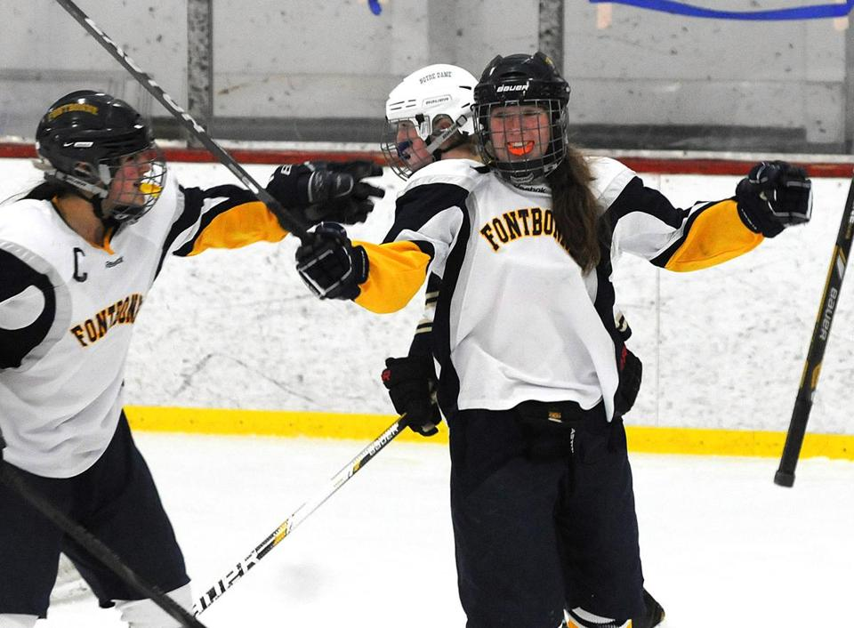 During the game's first period, Fontbonne's McKenna Russell (right) celebrated her goal.