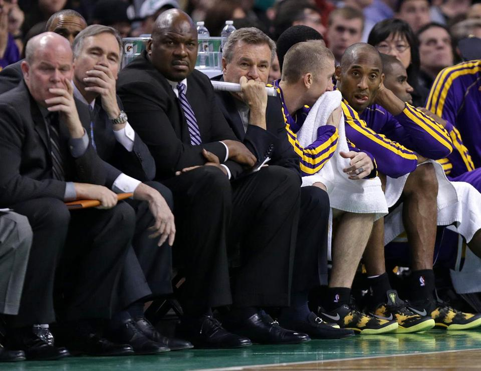 Kobe Bryant (right) was sitting late, coach Mike D'Antoni (second from left) sparing him the indignity of a blowout.
