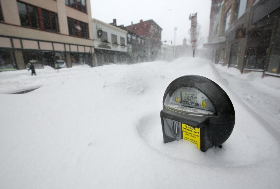 A parking meter emerged from the snow in Portland, Maine.