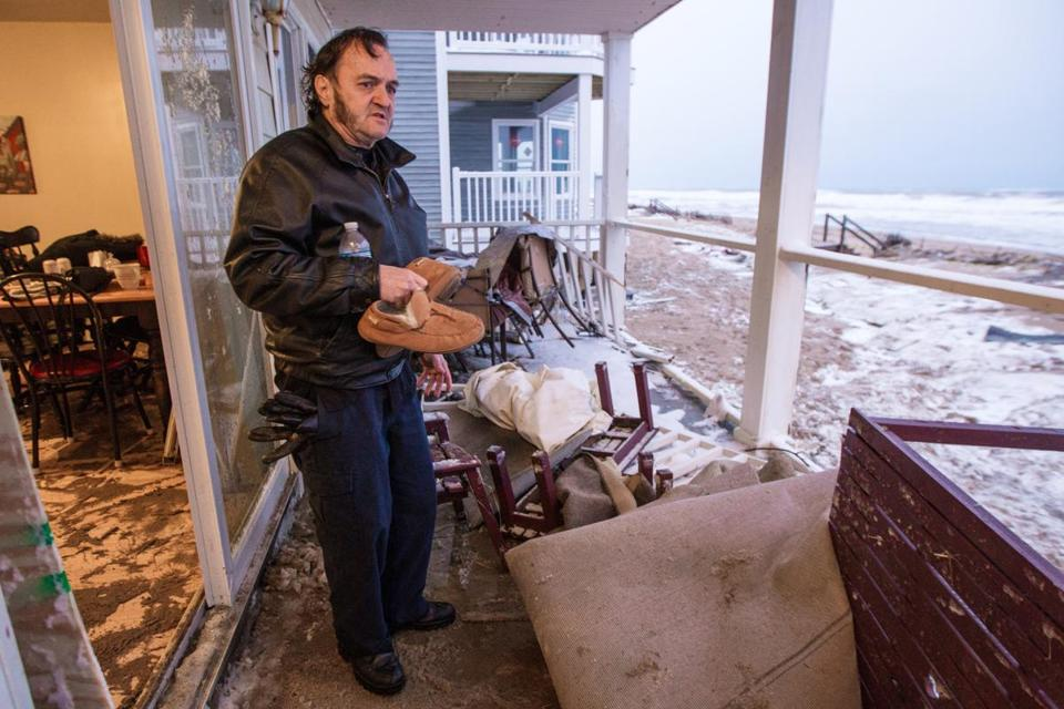 SALISBURY: Edward Bemis inspected the damage caused by a wave that crashed into the condominium he and his wife were renting on North End Boulevard.