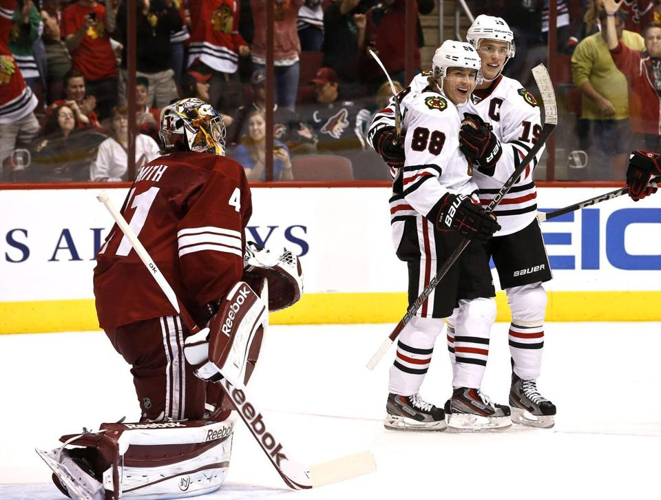 The Blackhawks' Patrick Kane (88) celebrated his goal in the second period with Jonathan Toews.