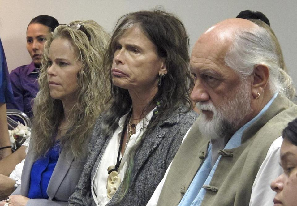Steven Tyler (center) with his attorney Dina LaPolt and Mick Fleetwood at the Hawaii Capitol in Honolulu on Friday.
