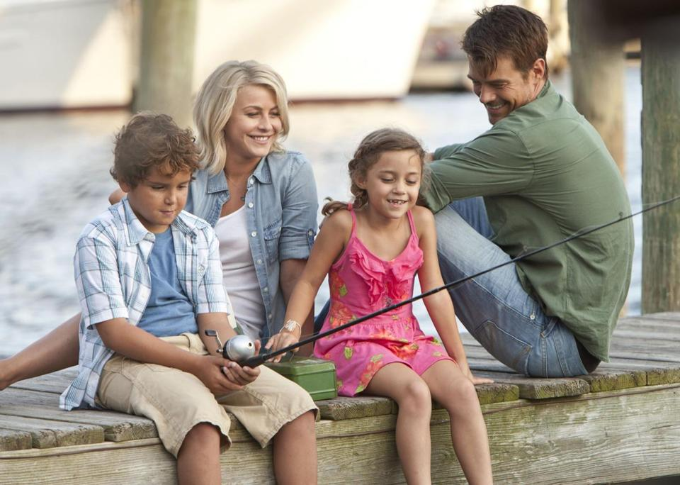 "Julianne Hough plays a woman on the run who finds love with a widowed dad (Josh Duhamel) and his kids (Noah Lomaz and Mimi Kirkland) in ""Safe Haven."""