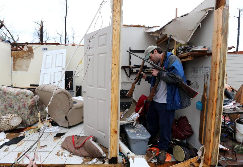 Hattiesburg, Miss., resident Charlie Ramp salvaged guns from his destroyed home Monday. Officials estimated that wind speeds from the tornado reached 145 miles per hour in parts of the city.