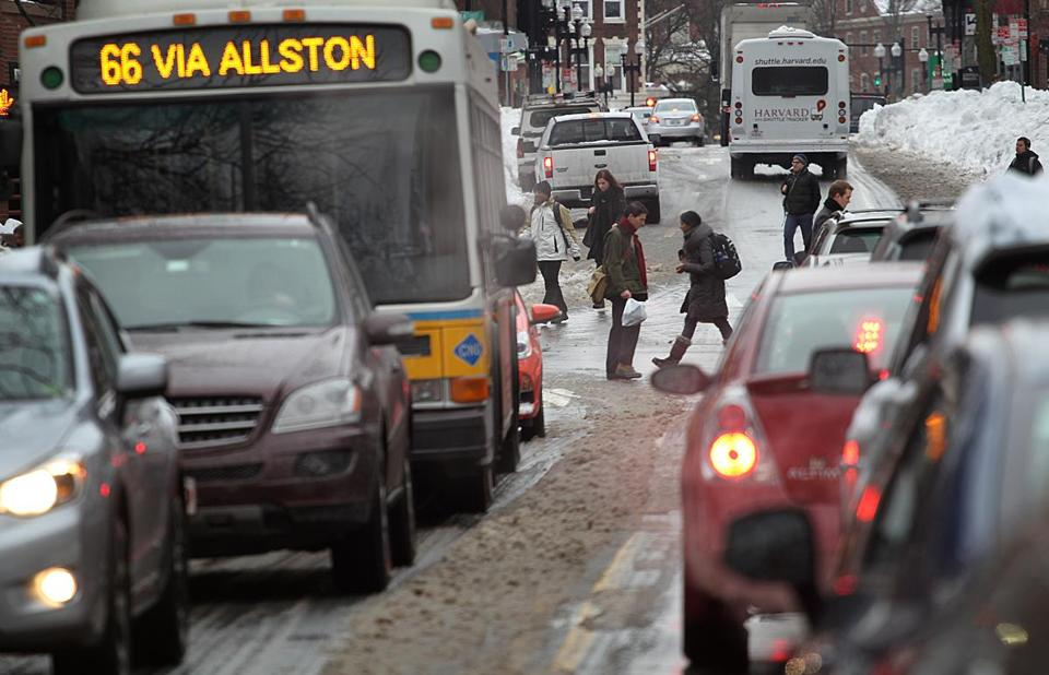Giant piles of snow made for a difficult commute for vehicles and pedestrians in Cambridge on Monday morning.
