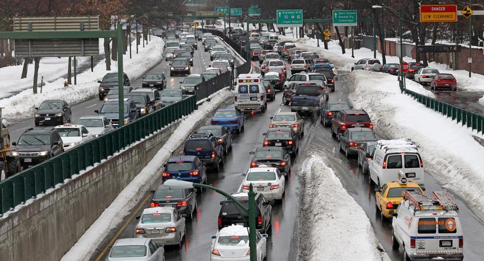 Traffic backed up as cars tried to navigate a snowy Storrow Drive on Monday morning.