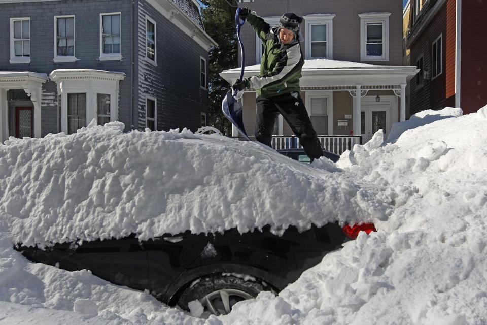 South Boston's Greg Polsen took the high road to attack the snow deposited on his car on M Street Sunday.