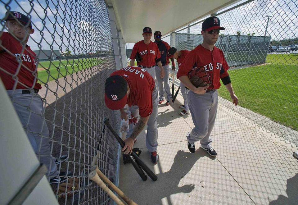 Dustin Pedroia, right, and Red Sox teammates during a workout in Fort Myers.