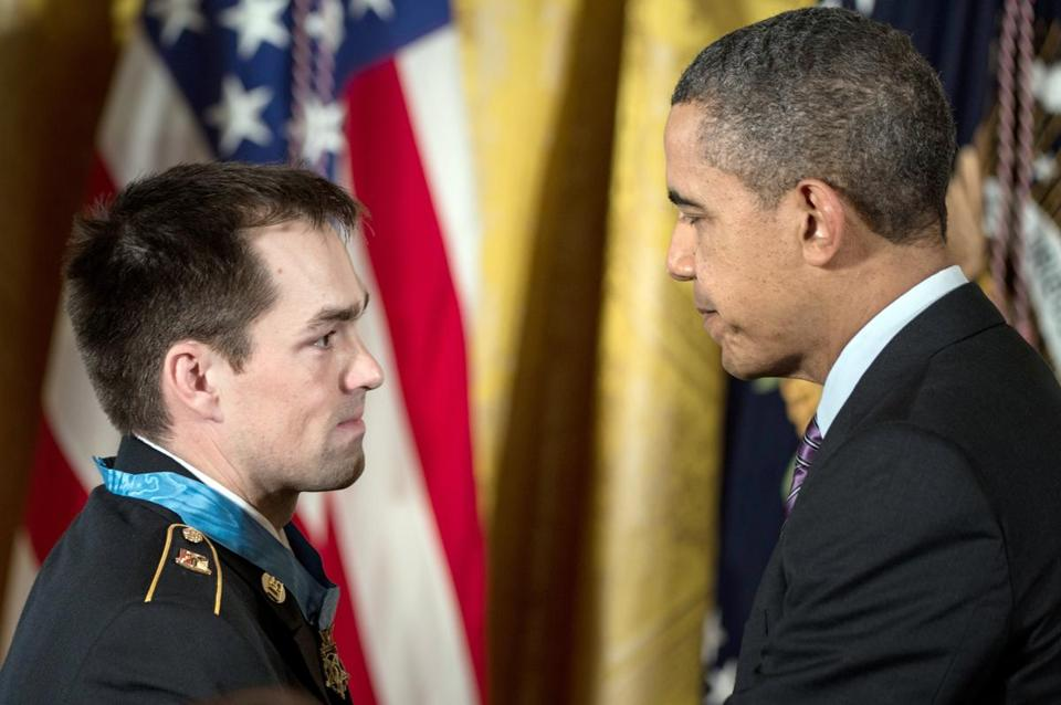 US Army Staff Sargent Clinton Romesha and US President Barack Obama during a Medal of Honor ceremony in the East Room of the White House February 11, 2013 in Washington, DC.
