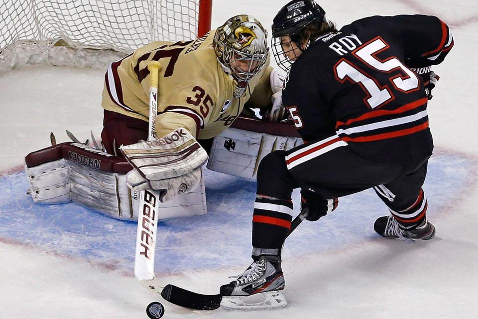 BC goalie Parker Milner made a stick save on NU's Kevin Roy in the third period.