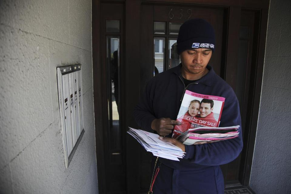 Grinje Fernandez delivered mail in San Francisco last week. The postal workers union opposes cutting Saturday delivery.