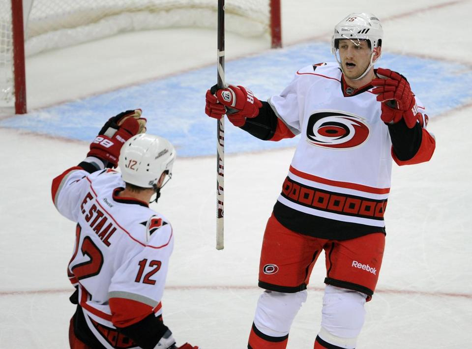 The Hurricanes' Jiri Tlusty scored an empty-netter to seal the win over the Devils.