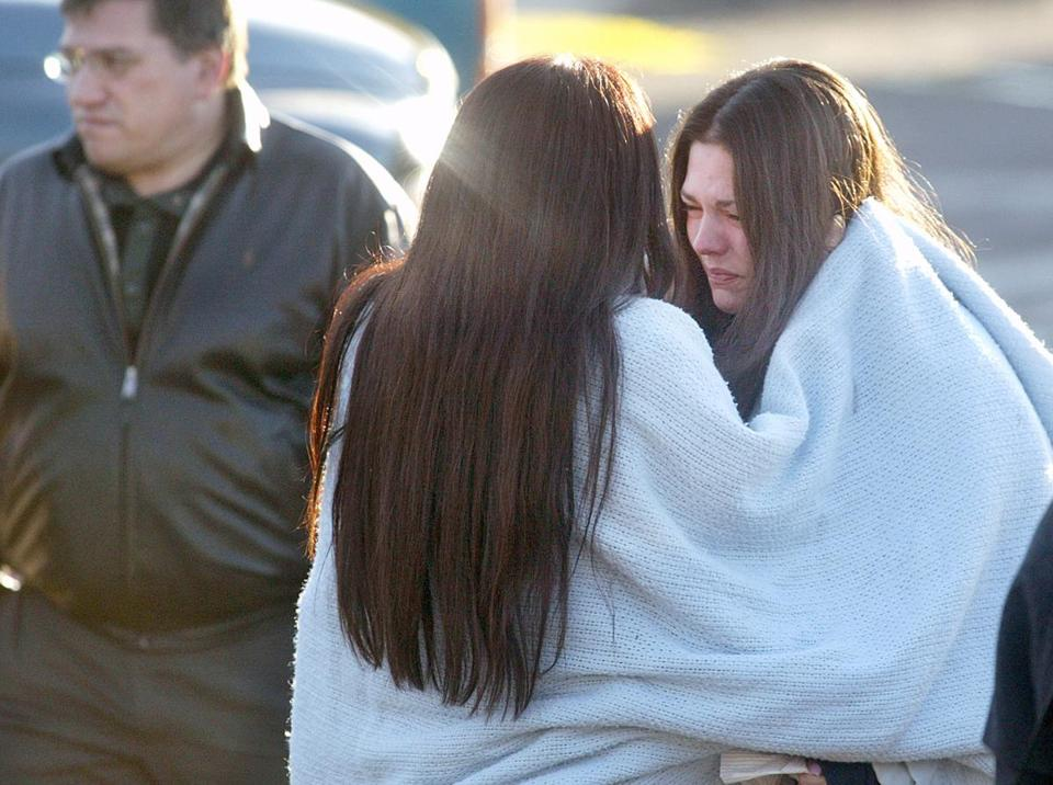 Robin Petrarca (right) and Jessica Studley comfort each other at the scene of the tragedy. The two were in the club when the fire broke out.