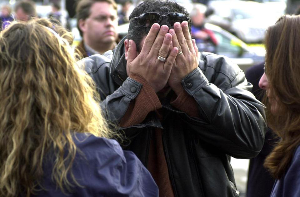 Mario Giamei of Sutton, a former employee at The Station, was overcome by emotion while awaiting word on some friends who were at the nightclub during the fire Thursday night.