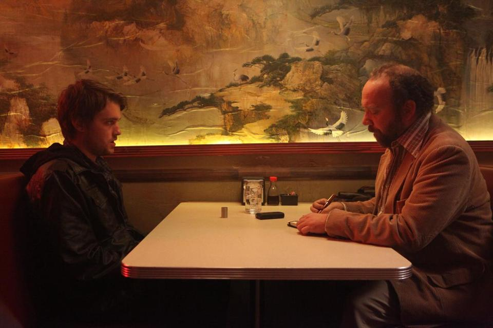 "Chase Williamson (left) and Paul Giamatti in ""John Dies at the End.''"