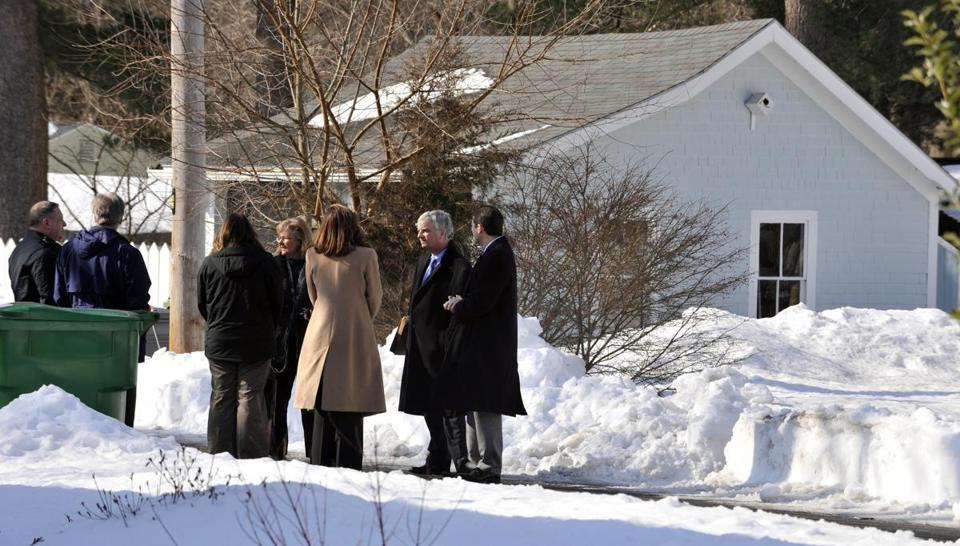 Jurors and court officers stood in front of the garage where prosecutors say Nathaniel Fujita killed Lauren Astley.