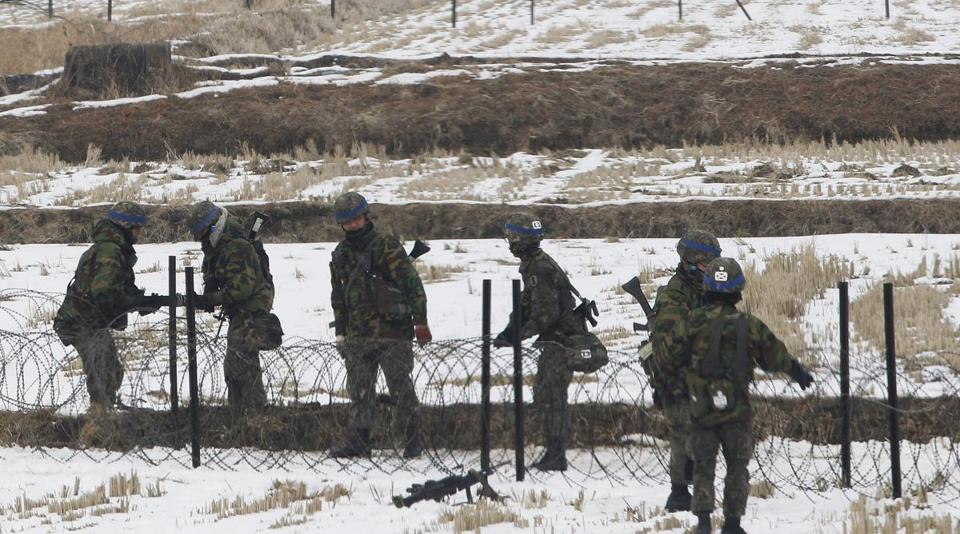 South Korean troops set up barbed wire fencing during a military exercise near the demilitarized zone in Paju, South Korea, on Thursday.
