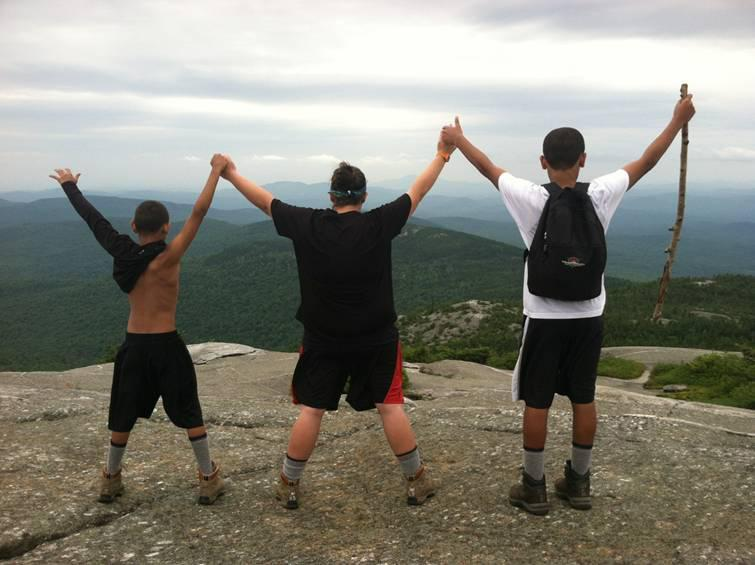 Boys celebrate a trip last summer to the summit of N.H.'s Mount Cardigan
