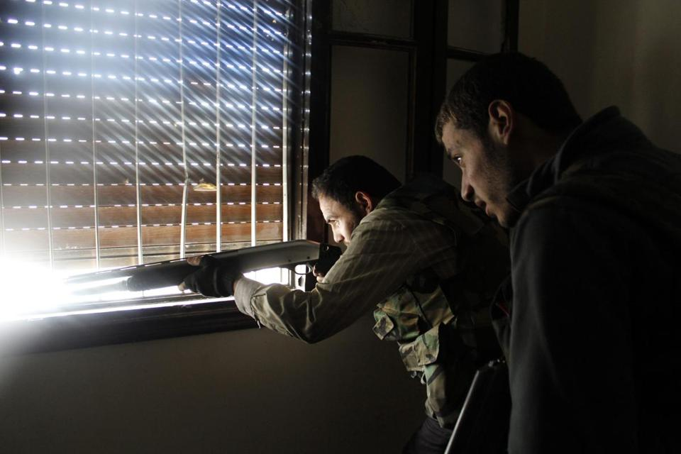 A Free Syrian Army fighter fired his weapon in a clash with forces loyal to President Bashar Assad in Aleppo.