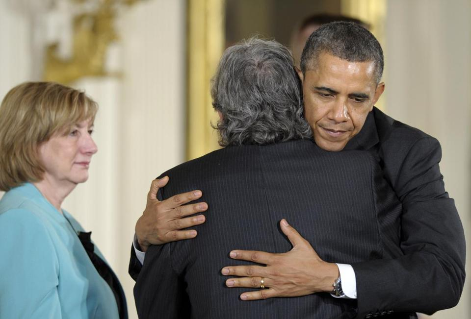 President Obama hugged Gilles Rousseau, father of slain Sandy Hook Elementary School teacher Lauren Rousseau, as her mother Terry Rousseau, watched at left during a ceremony to posthumously present their daughter with the 2012 Presidential Citizens Medal.