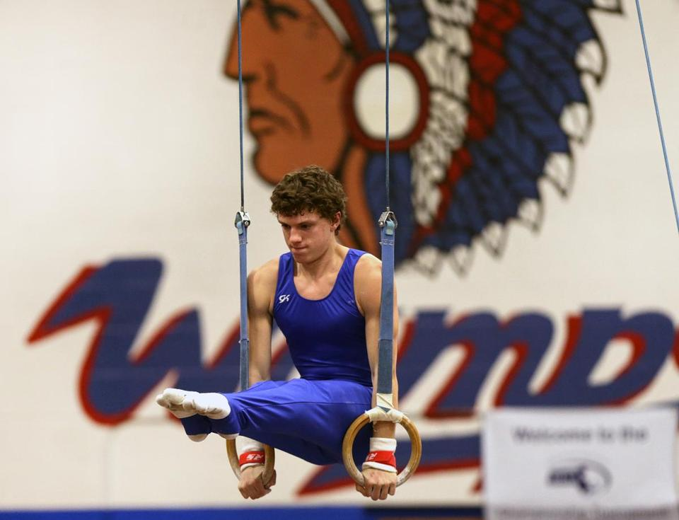 Braintree senior Nick Van Alfen on the rings last month at perhaps the last MIAA-sanctioned state championship for boys' gymnastics.