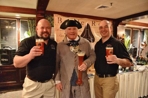 Battle Road Brewing Company owners Scott Houghton left and Jeremy Cross flank Dan Meenan of the Sudbury Minutemen at their launch at the Colonial Inn in Concord.