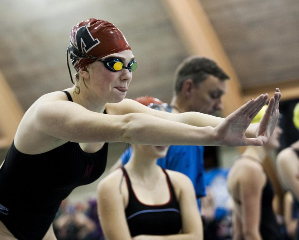 A Marblehead swimmer prepared for her leg of the 200-yard freestyle relay at the Division 2 state championships at Springfield College on Feb. 16.