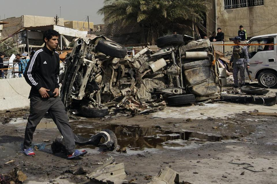 An Iraqi man walked past the scene of a car bomb attack in the Ameen neighborhood of eastern Baghdad.