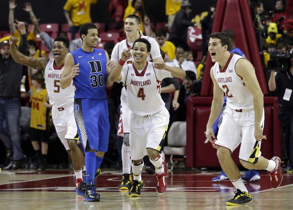 Maryland's Seth Allen (4) and Logan Aronhalt (2) begin the celebration after pulling off an ACC upset over No. 2 Duke.