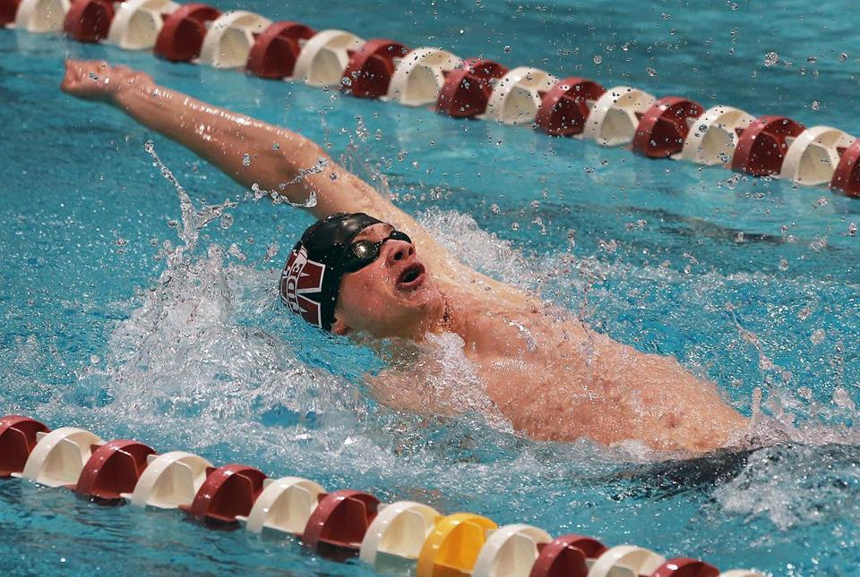 Weston's Jack Blyzinskyj is on his way to victory in the 100 backstroke during the Division 2 state meet at Harvard. Blyzinskyj also won the 50 free in a state record time of 20.50.