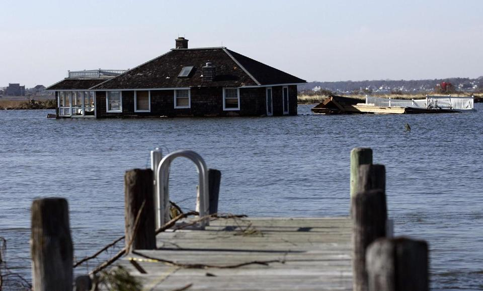 A house was carried in to the bay by Hurricane Sandy in Mantoloking, N.J. Many objects lurk beneath the water.