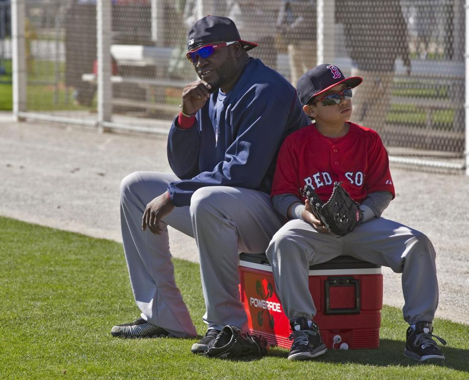David Ortiz watched batting practice with his son, D'Angleo, at spring training.