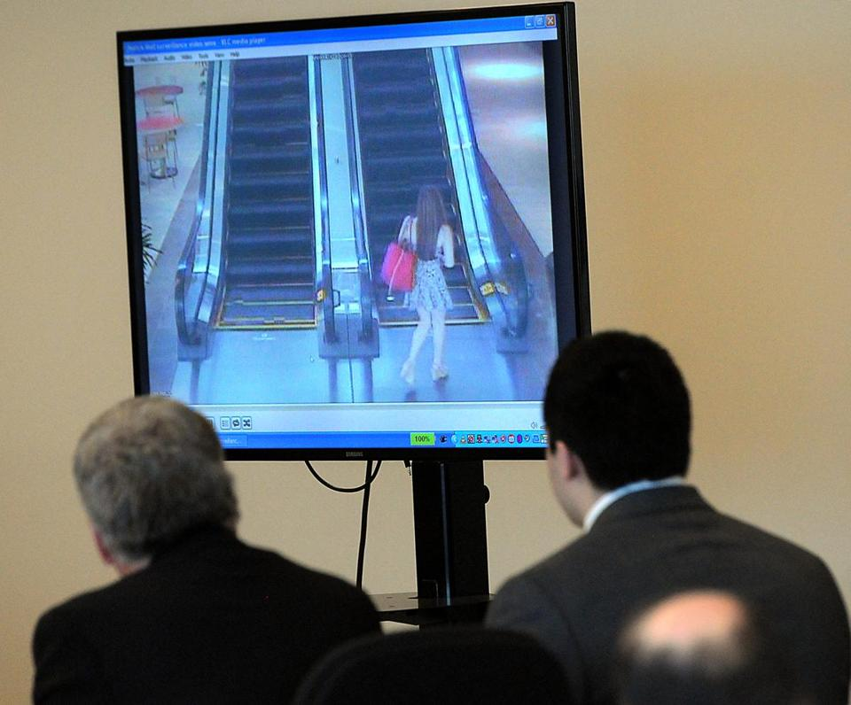 Nathaniel Fujita (right) and defense attorney William Sullivan watched footage of Lauren Astley.