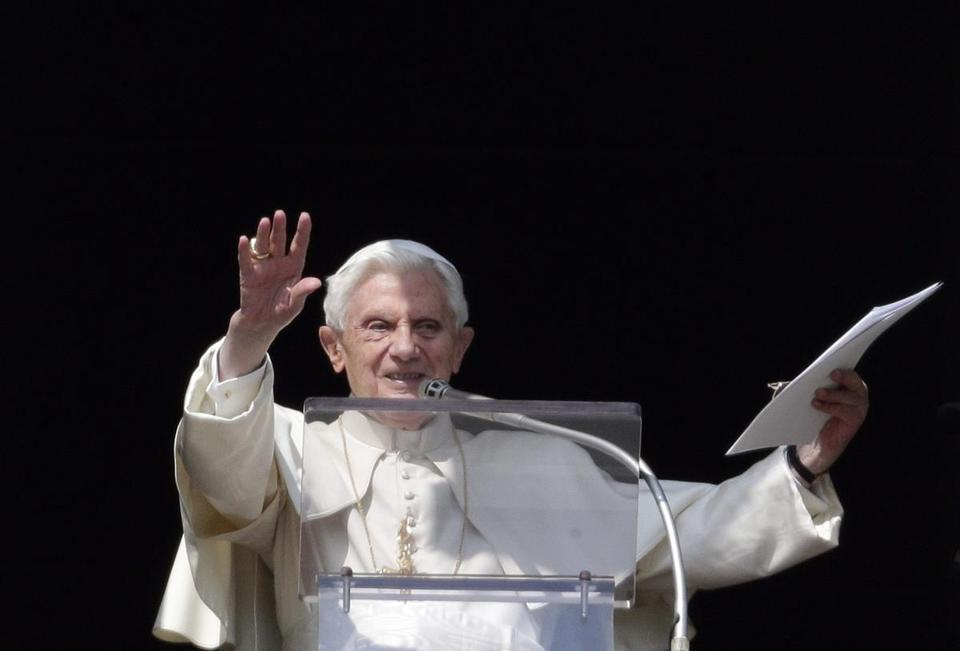 Pope Benedict XVI waved as he lead the Sunday Angelus prayer in Saint Peter's Square at the Vatican.