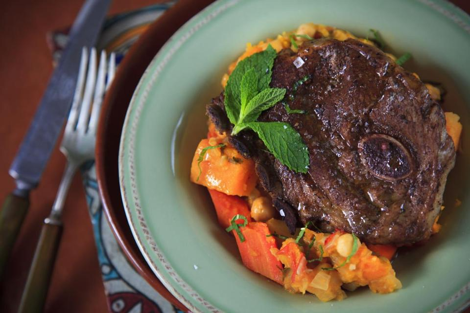 Lamb chops with squash, chickpeas and potatoes.