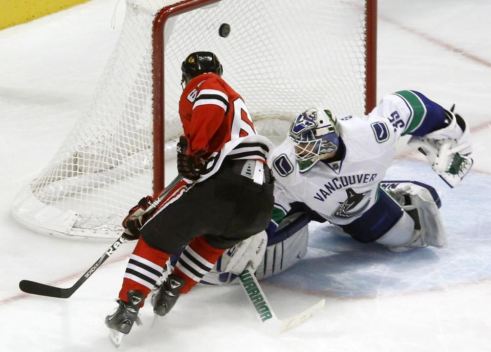Blackhawks' Andrew Shaw goes top shelf to beat Vancouver goalie Cory Schneider in Chicago's win.
